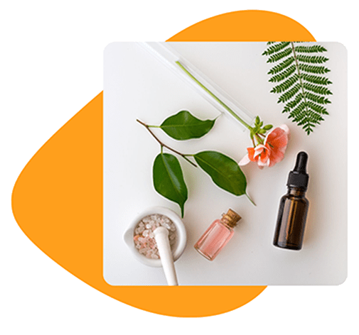 Essentials oils that can help with treating acne is laid out on a flat white surface